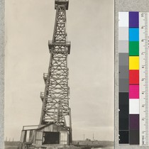 A 122' wooden oil well derrick. The derrick foundation and pump house ...