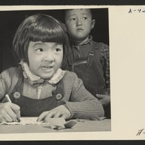 A third grade student at the Manzanar Relocation Center for evacuees of ...