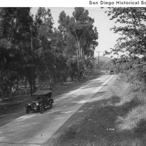 1922 Oldsmobile on tree-lined Highway 80