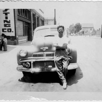 Yoshio Harry Tsuruda leaning against car in Los Angeles