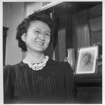 Mrs. Peter Sugawara is shown with a picture of her husband, Cpl. ...