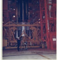 Bruce Herschensohn at launch site with camera and John Glenn, 1962