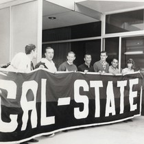 "Students holding up a banner which reads ""CAL-STATE"""
