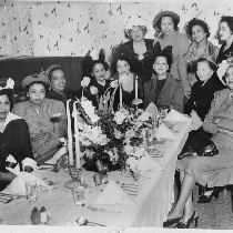 Group of women seated at banquet table at Slim Jenkins Bar and ...
