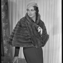Actress Gail Patrick modeling a mink fur stole from Beckman's, 1933