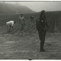 Police officer and lettuce farmers