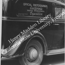 "1935 Chevrolet Master DeLuxe, sign on window reads ""Official Photographers, California Pacific ..."