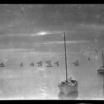 Boats at sea, canoes with sails