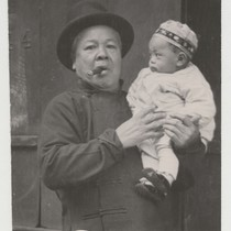 [man holding baby]