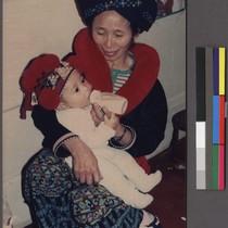 Mien woman feeding a baby