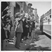 Inhabitants of the Japanese section wave farewell at the departure of their ...