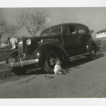 Angel Cabral sitting in front of family car, South Whittier, California