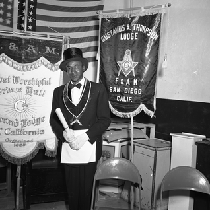 Al Fulcher wearing mason regalia standing next to Gustavus A. Thompson Lodge ...