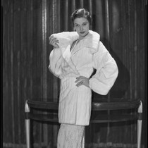 Actress Gail Patrick modeling a white Russian ermine coat, 1932