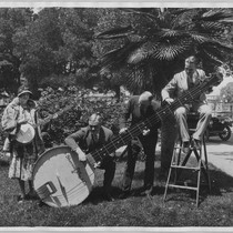 Sherman, Clay and Co. publicity photo with giant banjo [ca. 1925]