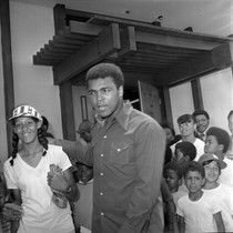 Muhammad Ali and a girl with a baseball glove