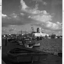 [Harbor front scene with fishing boats and the Civic Center in the ...