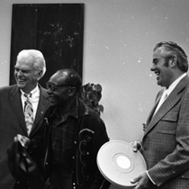 Blues musician Jesse Fuller laughing with KPIX general manager Al Constant (left) ...