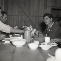Four Mexican workers eating in dining hall