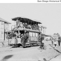 People on a double-deck streetcar operated by the San Diego Electric Railway