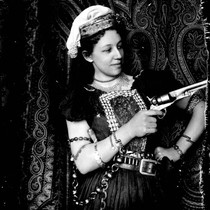 An actress holding a pistol in an unidentified production by the California ...