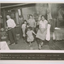 Typical Hooverville family inside the home made frome [sic] materials not recognised ...
