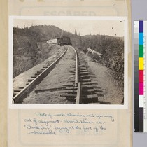Photo of wreck, show rail sprung out of alignment, also Pullman car ...