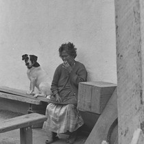 Filipino woman with dog, from Walnut Grove: Portrait of A Town