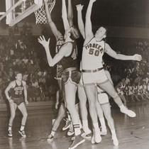 A photograph of the California State University, Hayward Basketball Team facing off ...
