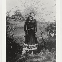 Dancer with feather headress and elderberry clappers