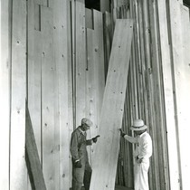 Company president inspects lumber