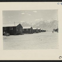 Manzanar, Calif.--Far end of barrack row looking west to the desert beyond ...