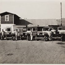 Armstrong Dairy, men in front of dairy with trucks, 1932