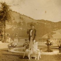 Alice Oge, and dogs, on the east side of the Beale house ...