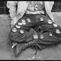 Boy selling painted stones on his legs, Haight-Ashbury 1967