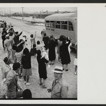 A crowd of Topaz Center residents wave farewell as one of the ...