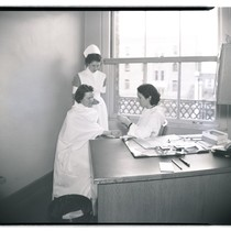 Clinician and nurse with San Francisco General Hospital chest clinic patient