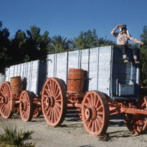 Man sitting atop a twenty mule team borax wagon at Furnace Creek