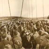 A crowd of invited guests celebrate the completion of the Golden Gate ...