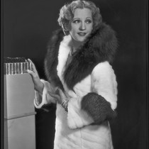 Actress Juliette Compton modeling an ermine coat from Beckman's, 1932
