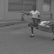 Girls running with banana box, from Walnut Grove: Portrait of a Town