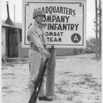 Private Noyama of Headquarters Company, 442nd combat team, stands guard at the ...