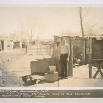 Hooverville, Sacramento, California. A few outdoor standpipes such as this constitute Hooverville's ...