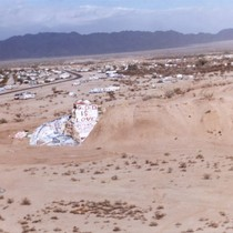 Slab City: photograph of Salvation Mountain with Slab City in the distance