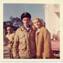 Chuck Waters and Eva Marie Saint pose on set