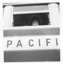 Hayward, Calif.--A young evacuee looks out the window of evacuation bus before ...