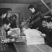 Assembling and folding the Sentinel, Heart Mountain Relocation Center newspaper