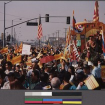 Hi-Tek protestors carrying American and Vietnamese flags