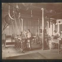 [Factory workers. Making chocolate bars?]