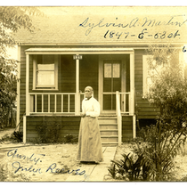 Julia Reeves [?] standing in front of house of Sylvia A. Martin, ...